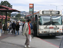 People board a San Francisco MUNI bus at San Francisco State University.
