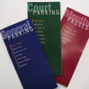 Photo of information pamphlets on parking and transit services.
